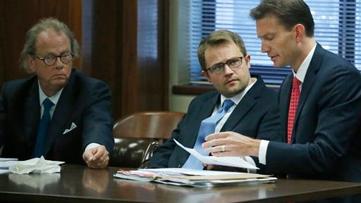 Preston Rhoads, center, talks with one of his defense attorneys, right, Jay Husbands, at the defense table during his hearing in Oklahoma City, Thursday, July 16, 2015. Rhoads pleaded guilty to solicitation for murder and was sentenced to 20 years in prison after apologizing to the intended victim. At left is defense attorney, John W. Coyle III. (AP Photo/Sue Ogrocki)