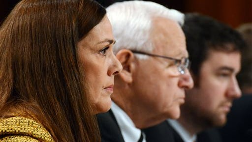 Sens. Lisa Baker, left, and Gene Yaw, center, listen during the first public hearing of a special Pennsylvania Senate committee set up to determine whether to seek removal proceedings against Attorney General Kathleen Kane on Monday, Nov. 9, 2015 in Harrisburg, Pa.