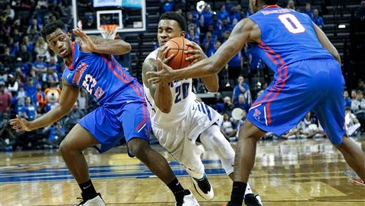 Memphis guard Ricky Tarrant Jr., center, is fouled while driving the lane against Louisiana Tech defenders Da'Shawn Robinson, left, and Alex Hamilton during Tuesday's game.