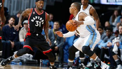 Denver Nuggets guard Randy Foye, right, works the ball inside as Toronto Raptors forward Terrence Ross defends in the first half of an NBA basketball game Monday, Feb. 1, 2016, in Denver. (AP Photo/David Zalubowski)