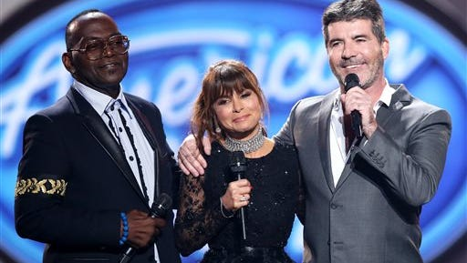 """Randy Jackson, from left, Paula Abdul, and Simon Cowell speak at the """"American Idol"""" farewell season finale at the Dolby Theatre on Thursday, April 7, 2016, in Los Angeles. (Photo by Matt Sayles/Invision/AP)"""