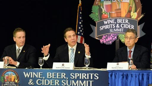 Gov. Andrew Cuomo, center, Lt. Gov. Bob Duffy, left, and Assembly Speaker Sheldon Silver speak during the Wine, Beer, Spirits and Cider Summit, Tuesday, April 8, 2014, in Albany, N.Y. (AP Photo/Albany Times Union, John Carl D'Annibale)