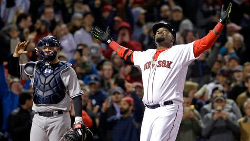Boston Red Sox designated hitter David Ortiz celebrates his two-run home run as New York Yankees catcher Brian McCann waits during the eighth inning of a baseball game at Fenway Park on Friday, April 29, 2016, in Boston. The Red Sox won 4-2.