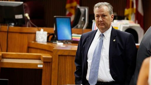 Alabama House Speaker Mike Hubbard stands in Judge Jacob Walker's courtroom before the start of his ethics trial on Tuesday, May 24, 2016  in Opelika, Ala. Hubbard is on trial on 23 felony ethics violations that could result in his removal from office.  (Todd J. Van Emst/Opelika-Auburn News via AP, Pool)
