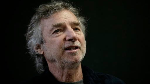 """U.S. filmmaker Curtis Hanson speaks during an interview at the International Book Fair in Guadalajara, Mexico in 2009. Hanson"""" has died Tuesday in Los Angeles."""