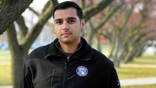 In a photo from Thursday, Nov. 17, 2016, Oakland University senior Michael Banerian stands on campus in Rochester, Mich. Banerian, a Republican representative to the Electoral College has been receiving death threats.