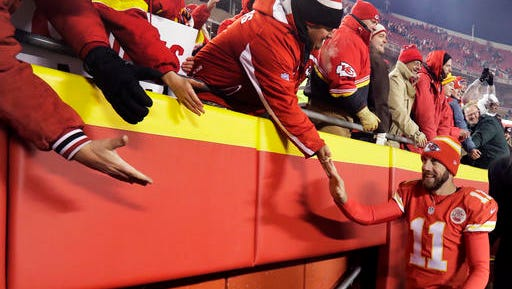 Kansas City Chiefs quarterback Alex Smith walks off the field after an NFL football game against the Oakland Raiders Thursday, Dec. 8, 2016, in Kansas City, Mo. The Chiefs won 21-13. (AP Photo/Charlie Riedel)