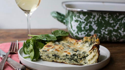 This November 2016 photo shows white and green spinach lasagna in New York. This dish is from a recipe by Katie Workman.