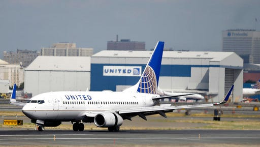 FILE - In this Sept. 8, 2015, file photo, a United Airlines passenger plane lands at Newark Liberty International Airport in Newark, N.J. Twitter users are poking fun at United's tactics in having a man removed from an overbooked Chicago to Louisville flight on April 9, 2017.