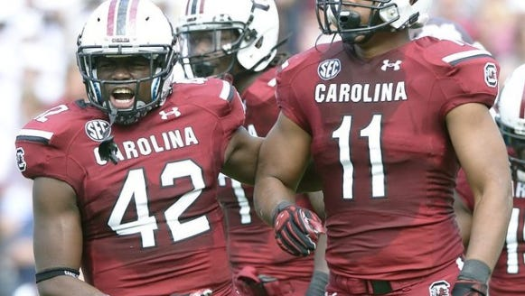 South Carolina linebacker T.J. Holloman (11) and safety Jordan Diggs (42) return for the Gamecocks.