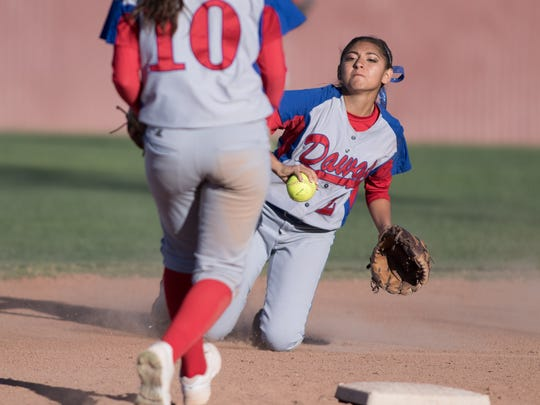 Las Cruces High's Brianna Bustillos tosses the ball to Rylan Gonzales to get the out at second.