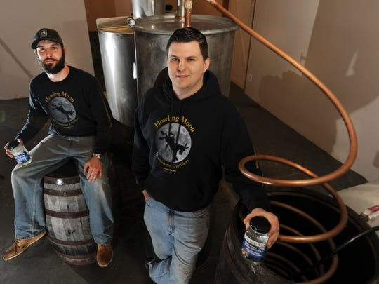 Chivous Downey, left, and Cody Bradford  are the founders of Howling Moon  distillery.