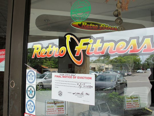 An eviction notice on the entrance to Retro Fitness, which permanently closed last week in Kings Lake Square shopping center on Davis Boulevard in East Naples.