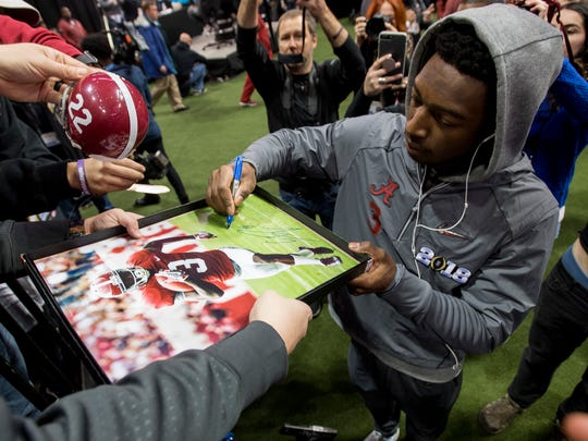 Alabama wide receiver Calvin Ridley (3) signs an autograph