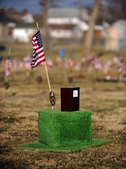 Mark Elkins' cremains sit on a riser Tuesday, Jan. 30, 2018, in Greenlawn Cemetery in Chillicothe.