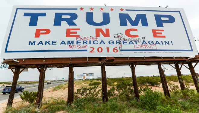 A Donald Trump billboard, posted on the westbound side of US 70 between Mesa Grande Avenue and Sonoma Ranch Boulevard and shown here on Monday, Sept. 26, 2016, is defaced with graffiti.