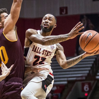 Ball State's Jeremie Tyler charges into the defense