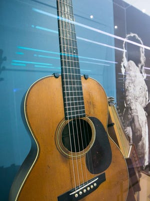 An acoustic guitar that belonged to Johnny Cash.