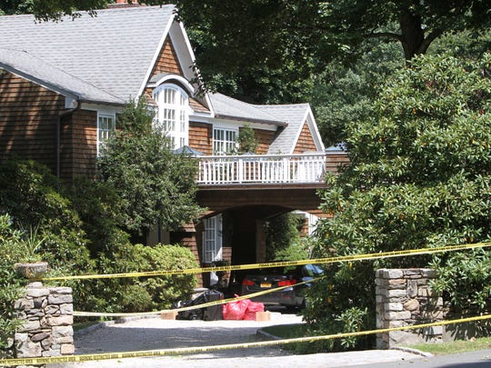 Crime scene tape outside 23 Fox Hill Road in Pound Ridge Aug. 26,  2017. A father killed his wife and teenage daughter and then himself in a murder-suicide on Friday at a home.