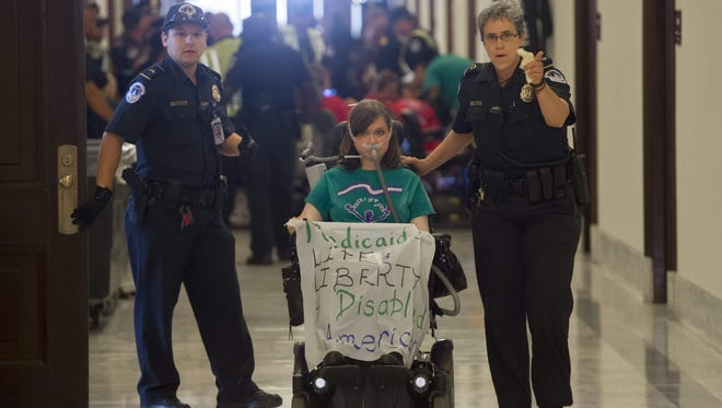 U.S. Capitol Police arrest a health care protester outside the office of Senate Majority Leader Mitch McConnell on June 22, 2017.