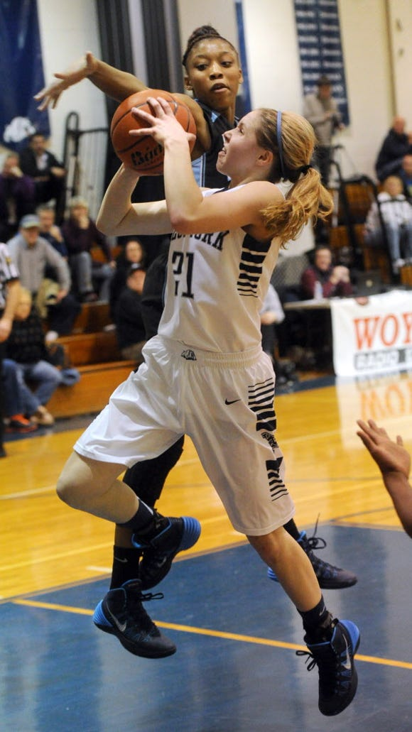 West York's Kari Lankford goes up for a shot against Dallstown's Amari Johnson during the Bulldogs' 41-30 victory at West York on Monday, Jan. 6, 2014. Jason Plotkin - Daily Record/Sunday News