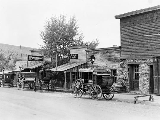 The first meeting of leading Montana Territory leaders that led to the creation of the Montana Historical Society was in the Dance and Stewart Store at the far left of this photo of Virginia City's Wallace Street.