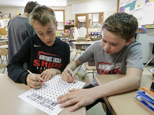 Fifth-graders Seth Gibeault, left, and Brayden Steinbecker play a multiplication game during a math lesson at Stangel Elementary School May 3. Under a new Manitowoc Public School District proposal, Stangel students would move to Riverview Early Learning Center, which would become a 4K through fifth-grade elementary school.