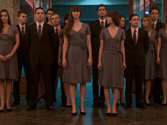Dominika (Jennifer Lawrence, center left) receives