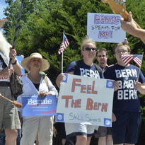 Participants in a rally in support of U.S. Sen. Bernie Sanders' presidential bid gather on the steps of the Vermont Statehouse in Montpelier on Sunday.