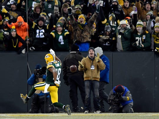 Green Bay Packers wide receiver Randall Cobb (18) celebrates in the endzone after a 30-yard catch in the third quarter. The Green Bay Packers defeated the New York Giants 38-13 in the NFC Wild Card playoff game at Lambeau Field in Green Bay, WI on Sunday, January 8, 2017.