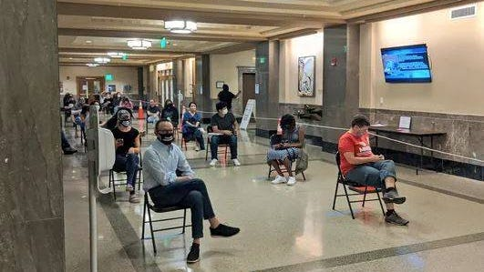 Nashvillans waiting outside the chamber on June 2. They came to speak before the Metro council regarding the city's budget.