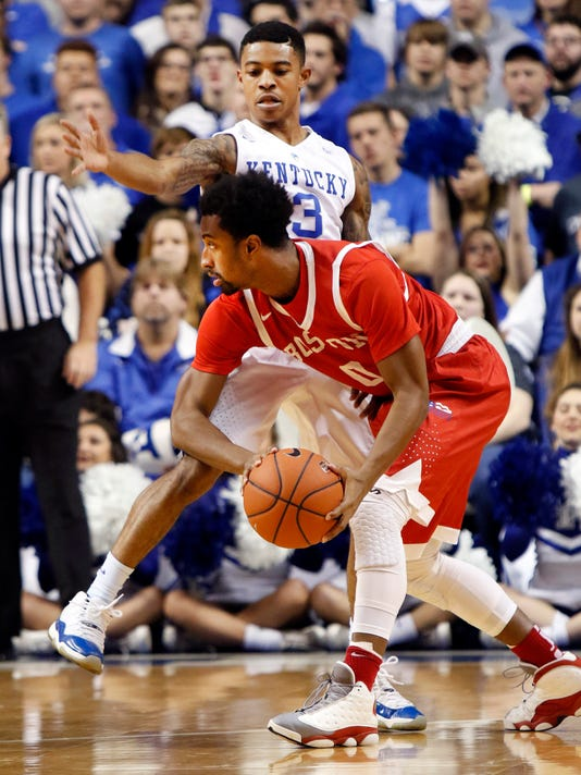 Boston University's Eric Johnson, bottom, looks for a teammate while defended by Kentucky's Tyler Ulis during the first half of an NCAA college basketball game Tuesday, Nov. 24, 2015, in Lexington, Ky. (AP Photo/James Crisp)