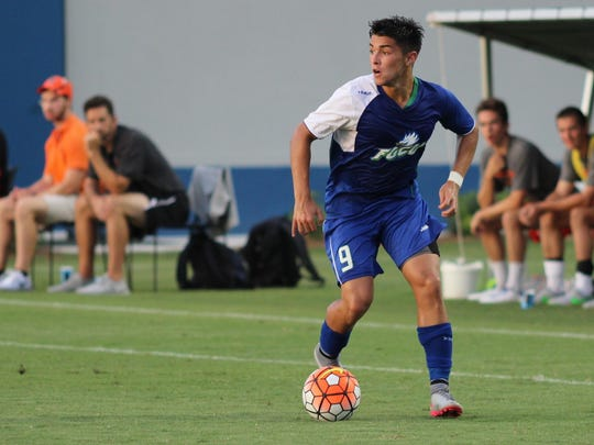 FGCU freshman Dylan Sacramento makes a run up the field during FGCU's match against Princeton Thursday night.
