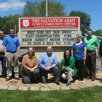 Five Fond du Lac chiropractor offices are competing in the Save a Sole Chiropractor Challenge to raise funds for 1000 children's shoes through July 31. From left are doctors Dr. Shayne Bauer, Ron Jacobson (Salvation Army), Dr. Scott Suprenand, Dr. Debra Corbett, Dr. Richard Moxon, Dr. Vickie Goldapske Dr. Gayle Martin, Dr. Craig Wink, and CT Aaron Quast.