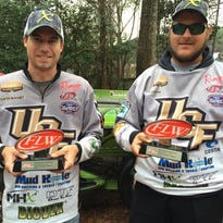 Hunter McKamey (left) and Kyle Oliver (right) hold up their first place trophies from the FLW College Fishing Southeastern Conference opener on Crescent Lake, Jan. 30. The win garnered the club $2,000 and advanced them to the 2017 FLW College Fishing National Championship.