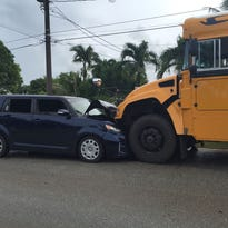 Girl, 7, hurt in auto-bus crash