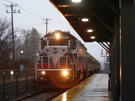 Wet snow begins to fall at Suffern train station on