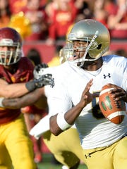 Quarterback Malik Zaire (8) came off the bench late in the first half against Southern Cal game and led two touchdown drives.