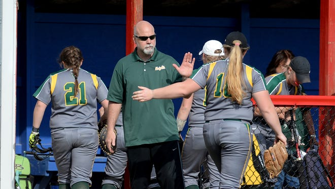 Northeastern softball coach Geoff Williams high fives Katie Schneider during a softball game Wednesday, April 20, 2016, in Liberty.