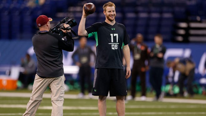 Feb 27, 2016; Indianapolis, IN, USA; North Dakota State Bisons quarterback Carson Wentz smiles prior to starting his work out during the 2016 NFL Scouting Combine at Lucas Oil Stadium. Mandatory Credit: Brian Spurlock-USA TODAY Sports