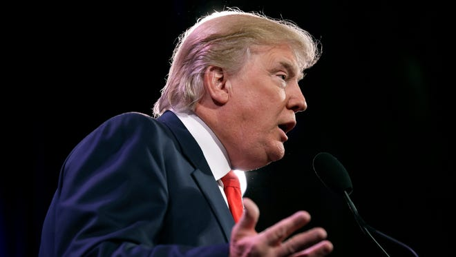 """Donald Trump speaks in Des Moines, Iowa on Jan. 24, 2014. Trump announced plans Wednesday to form a presidential exploratory committee. """"I am the only one who can make America truly great again,"""" the Republican businessman and reality television star declared in a statement announcing the move."""