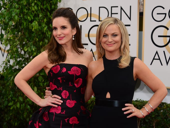 Tina Fey (L) and Amy Poehler arrive on the red carpet for the Golden Globe awards on January 12, 2014 in Beverly Hills, California.    AFP PHOTO / Frederic J. BROWNFREDERIC J. BROWN/AFP/Getty Images