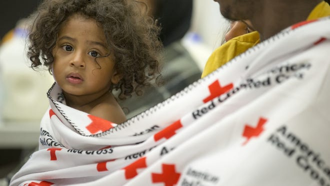 Anthony Hicks III, 1, sits with his family at a Red Cross shelter, at the Kokomo Event Center, a day after a tornado displaced them and dozens of other families in the central Indiana town, Kokomo, Thursday, August 25, 2016. The Hicks family said they moved to the area a week earlier, looking to escape crime in Chicago.