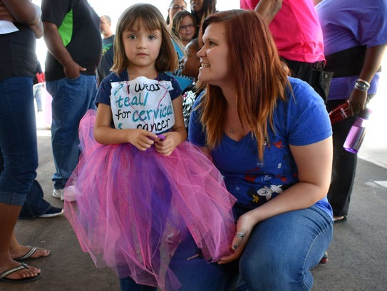 Harmony and Trish Jencks take a break from walking laps in honor of their loved ones during Relay for Life.