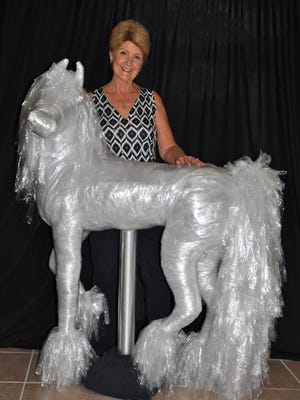 An avid recycler, Merritt Island artist Jill Jacobus Moore wanted to find renewed usefulness for dry cleaners' bags. The result, large ice-like sculptures.