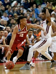 Alabama's Dazon Ingram (12) drives on Virginia Tech's