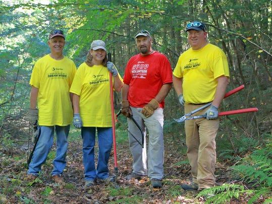 Volunteers from local firm Stantec build trail at Upper La Platte River Natu