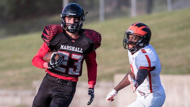 Marshall's Jarrett DeLand advances the ball during Friday's game against Jackson.