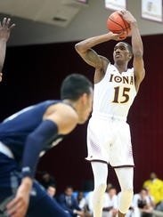 Iona College's Deyshonee Much (15) jump shot over Saint