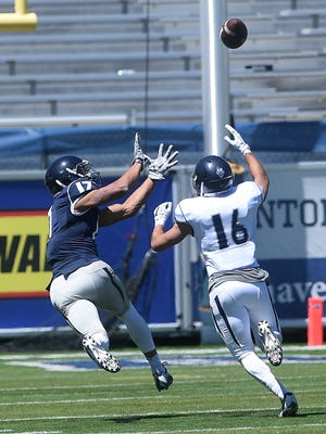 Nevada's Brendan O'Leary-Orange hauls in a pass from David Cornwell during the Wolf Pack's Silver & Blue Game.